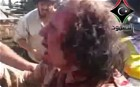 Amateur video has emerged of Colonel Gaddafi apparently wounded but still alive.