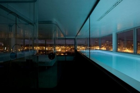 Indoor pool at Modern Penthouse Interior With Lot of Glass Windows and Door