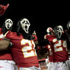 Wearing Halloween masks, players for the Kansas City Chiefs celebrate their 23-20 overtime win in an NFL football game against the San Diego Chargers, Tuesday, Nov. 1, 2011, in Kansas City, Mo. (AP Photo/Charlie Riedel)