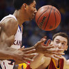 The ball bounces off the nose of Kansas forward Justin Wesleywhile he is covered by Pittsburg State guard Sam Pugh during the first half of an exhibition college basketball game in Lawrence, Kan., Tuesday, Nov. 1, 2011. (AP Photo/Orlin Wagner)