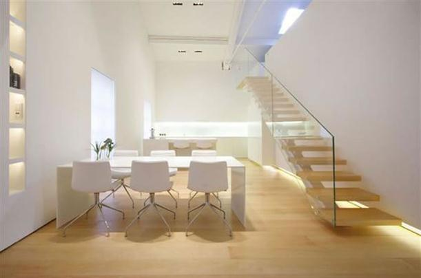 Dining and stairs at Modern and Minimalist Apartment Interior with White Wall