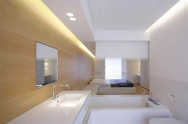 Bathtub at bedroom Modern and Minimalist Apartment Interior with White Wall