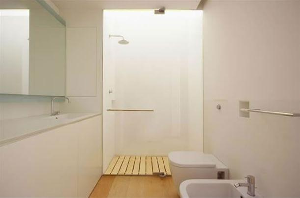 Toilet at Modern and Minimalist Apartment Interior with White Wall