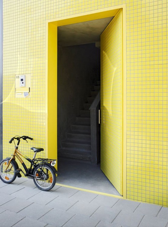 yellow door Contemporary Patio House with Bright Yellow Exterior Looking
