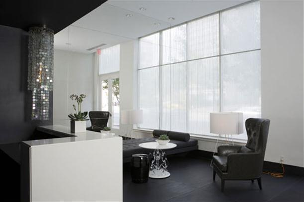 Lounge room on Black and White Apartment Interior Renovation