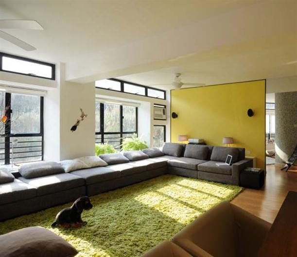 Green rugs and corner sofa at Contemporary Interior Design Matsuki Residence