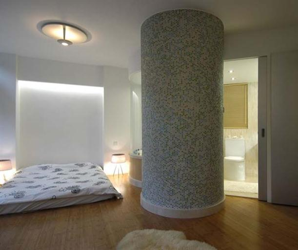 Master Bedroom with Large pillar at Contemporary Interior Design Matsuki Residence