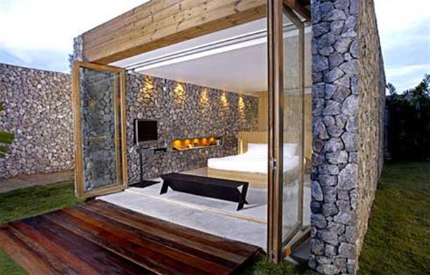 Master bedroom with unique stone wall at X2 Resort Kui Buri
