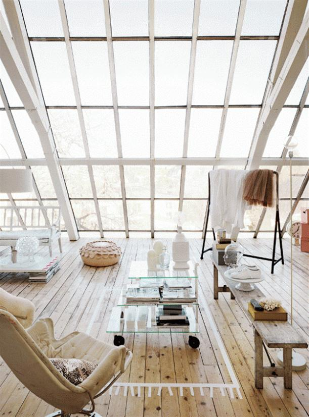 Relaxing-with-large-window-in-Romantic-Sweden-White-Apartment-with-Contemporary-Design