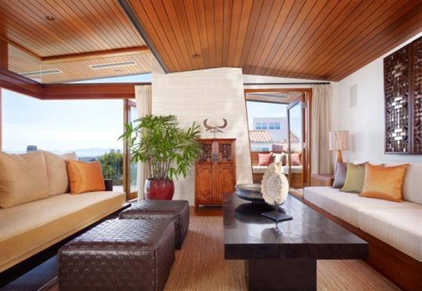 Lounge room at Contemporary Natural Tropical House Design features Garden