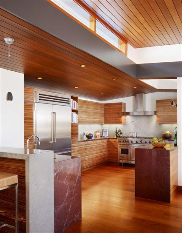 Kitchen interior at Contemporary Natural Tropical House Design features Garden