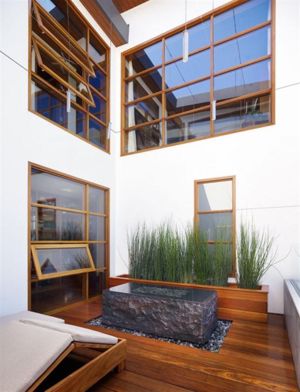 Outdoor retreat Contemporary Natural Tropical House Design features Garden