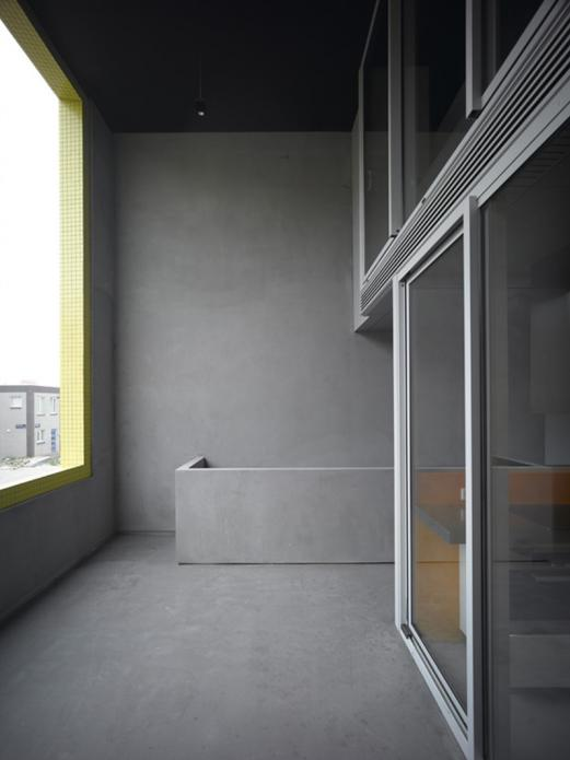 elegent grey color Contemporary Patio House with Bright Yellow Exterior Looking