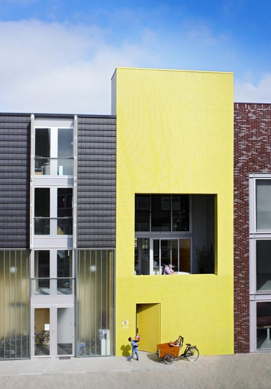 Contemporary Patio House with Bright Yellow Exterior Looking
