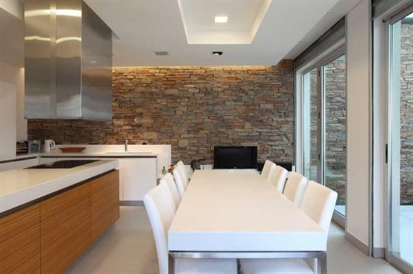 Kitchen and dining interior at Modern Home Design with Elevated Swimming Pool