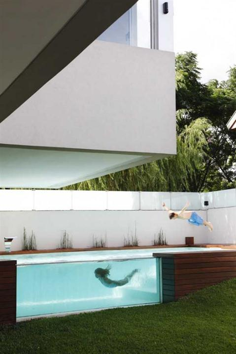 The pool looks from sideModern Home Design with Elevated Swimming Pool