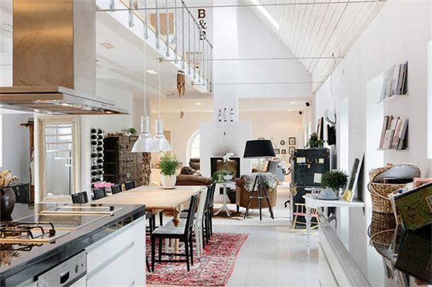 Kitchen and dining at Spacious and Bright Villa Design in Sweden