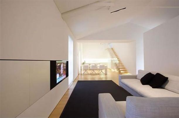 TV room Modern and Minimalist Apartment Interior with White Wall