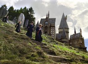 Friendships formed between Harry, Hermione and Ron at Hogwarts. UK locations including Alnwick Castle and Gloucester Cathedral have been used to create the wizard school.