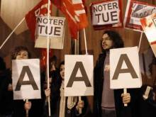 Euro empire totters on rating shock; France loses AAA status