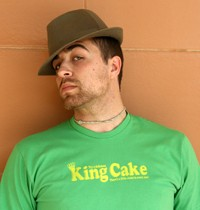 """LSU student Max Zoghbi models """"King Cake"""" by Storyville.  The t-shirt was designed by Elizabeth Harvey & Gabriel Harvey for Storyville.  The t-shirt is available in Storyville Austin, New Orleans and online at http://www.WearYourStory.com."""