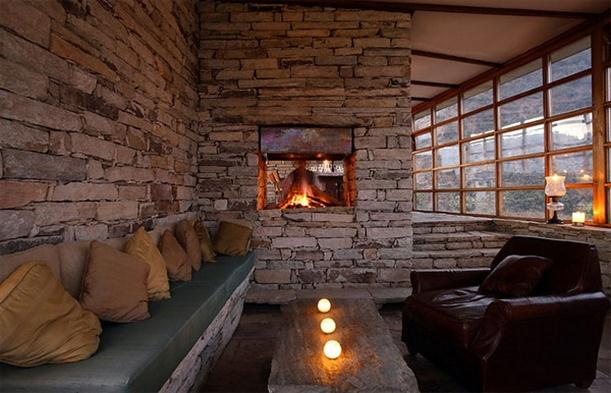 Fireplace at Mountain Home Design Features Stone and Glass Wall