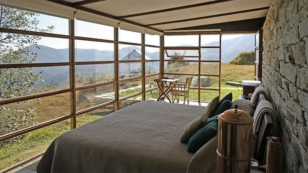Master Bedroom at Mountain Home Design Features Stone and Glass Wall