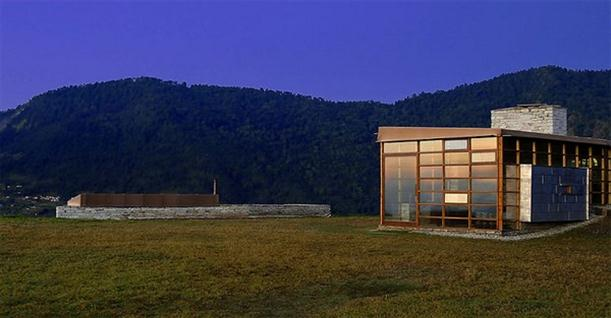 Lot of grass Mountain Home Design Features Stone and Glass Wall
