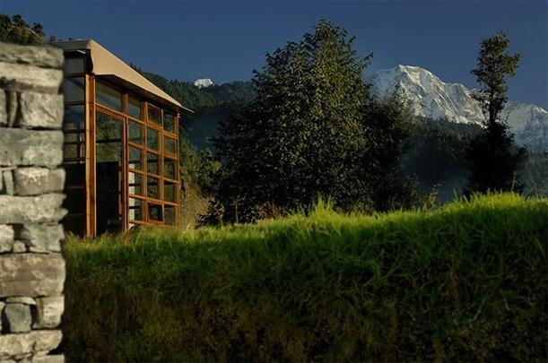 Himalayas Mountain Home Design Features Stone and Glass Wall