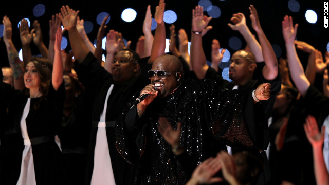 <br/>Signer Cee Lo Green performs on stage in a glittery choir robe. Earlier in the show he donned a marching band uniform.