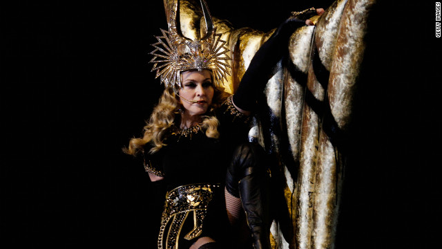 <br/>Madonna started her performance dressed as a Roman goddess clad in black and gold.
