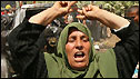 A Palestinian woman in Gaza reacts after an Israeli air strike destroys a car, killing one person and wounding four according to Palestinian medics - 19/4/2008