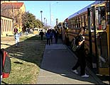 Photo of kids getting on school bus