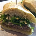 The Porchetta sandwhich (Italian pork roast) served on a baguette with arugula and pickled apples for a mix of salty and sweet at Hay Market in Willow Glen. Photo by Jeffrey Cianci / Spartan Daily