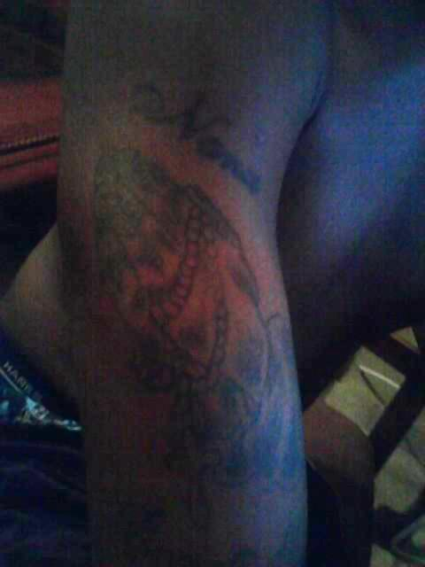 Trayvon Martin Arm Tattoo