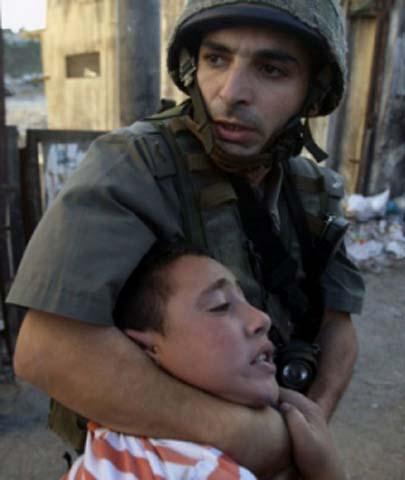 Child of about 8 years age beaten by an israeli soldier in Jerusalem - Pic Credit: Al-Ayyam-Reuters-KawtherSalam