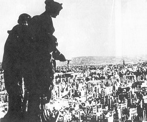 One of the most poignant photographs of the war, the statue of Justice still stands over the ravaged city of Dresden, in the streets below, the destruction is widespread and nearly complete