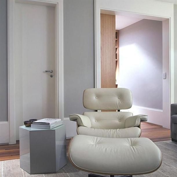 Lounge chair at Modern and Minimalist Apartment Interior Design with Calm Color