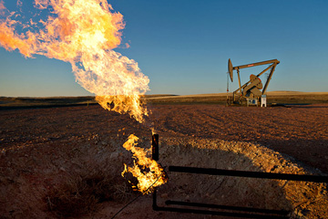 Natural gas is flared at a crude oil well site outside South  Heart, North Dakota.
