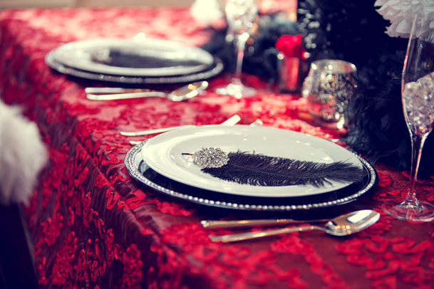 black feather table wedding red linen