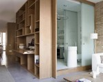 100 sqm Loft Renovated in Barcelona Bathroom behind cabinet