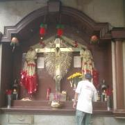 Incense sticks are part of Catholic worship in Chinatown's famous side chapels.