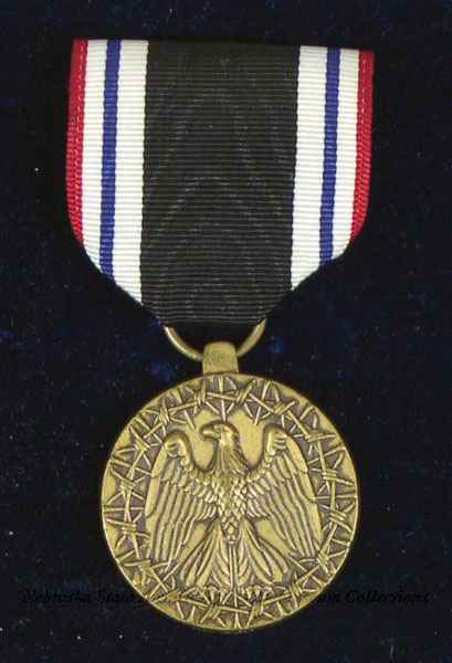 """Prisoner of War Medal awarded to Sterling following his incarceration in North Korea. The back of the medal is inscribed, """"Awarded to Charles Sterling for honorable service while a prisoner of war, United States of America."""""""
