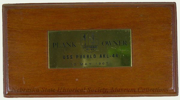 Plank Owner plaque.  A plank owner is a member of a ship's crew when it is first placed into commission or sometimes, re-commissioned.