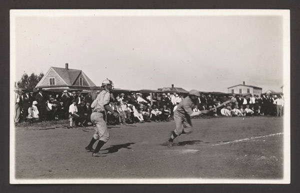 John Nelson's photograph of a baseball game includes a catcher with face mask in the left foreground. NSHS RG3542:PH:097-12