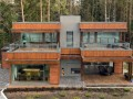 Wooden material Contemporary Forest House Design with Large Glass Batches