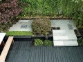 Ideas for Small Patios a black wooden deck