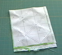 <center>Cut a rectangle of fabric to fit the paper grid</center>