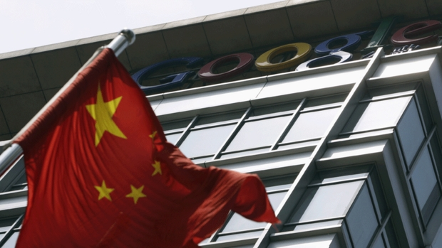 A Chinese national flag waves in front of the former headquarters of Google China in Beijing. Google closed the headquarters in 2010 after a series of hacking attacks traced to China. It has now said it will start flagging suspected state-sponsored attacks to its users.