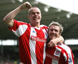 Ryan Shawcross and Liam Lawrence celebrate the latters goal at Hull City. ACTION IMAGES